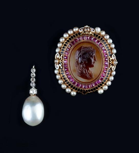 A natural pearl and diamond pendant and a 19th century cameo brooch Image