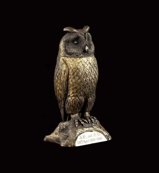 An Edwardian silver-gilt owl scent bottle Image